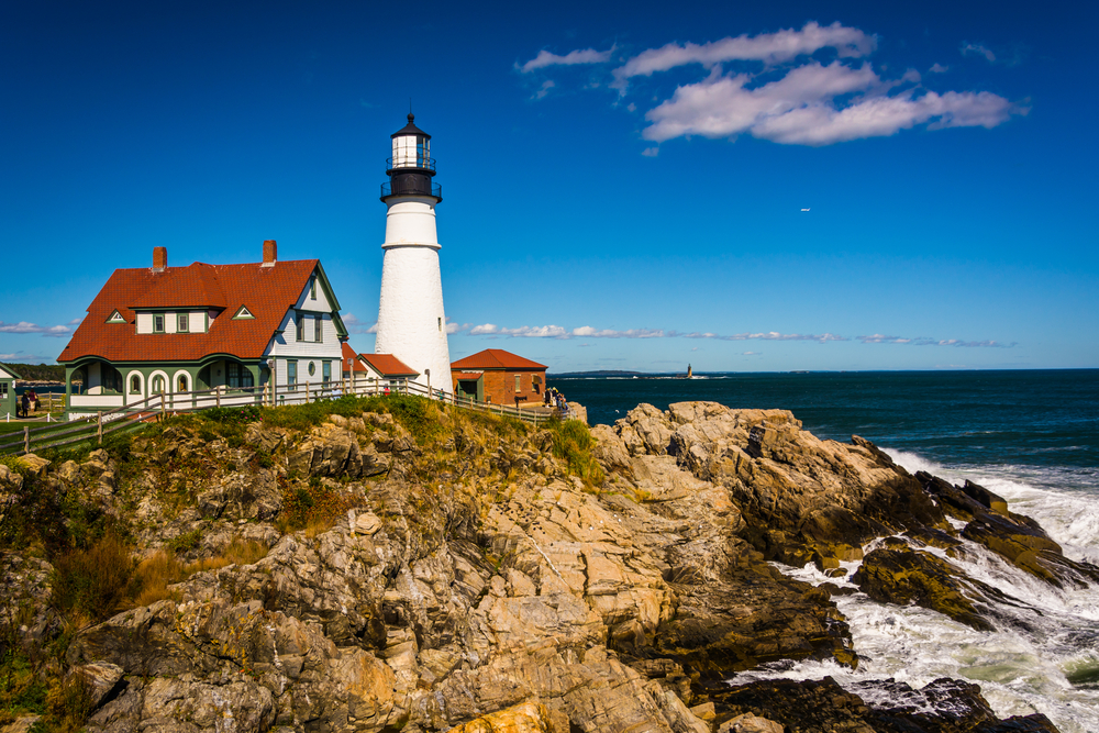 Portland Head Lighthouse and the Atlantic Ocean at Fort Williams Park in Cape Elizabeth, Maine.