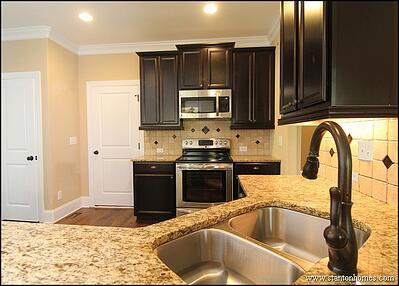 Kitchen color trends dark cabinets light countertops for Kitchen cabinets and countertop color combinations