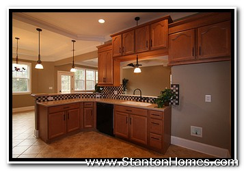 Kitchen with natural maple cabinets or a master bathroom with deep