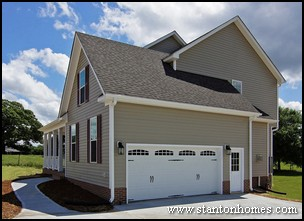 Custom home building and design blog home building tips for Cost to side a garage