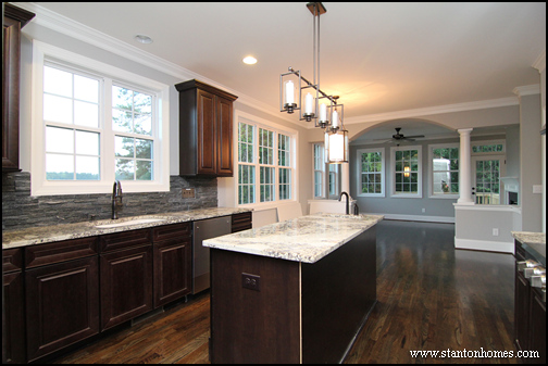 better kitchen  Mixing dark kitchen cabinets with light granite