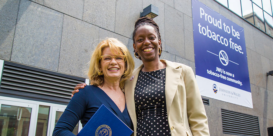 JWU Providence Campus President Mim Runey (L) with Director of the RI Department of Health Dr. Nicole Alexander-Scott (R)