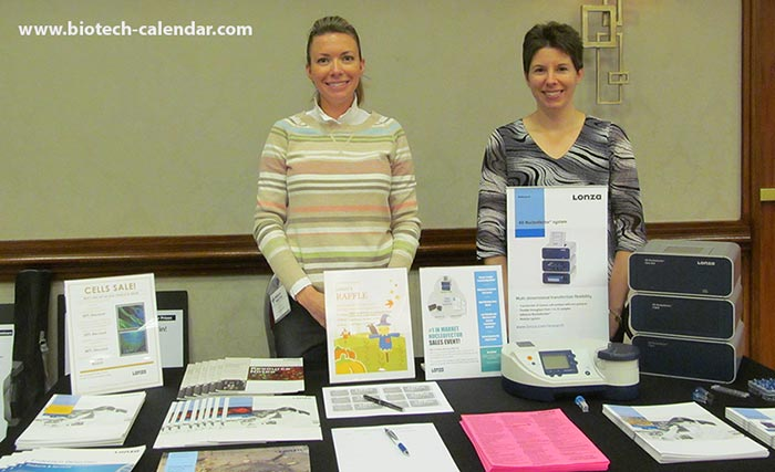 Bioresearch vendors smiling at Biotechnology Calendar, Inc's trade show.