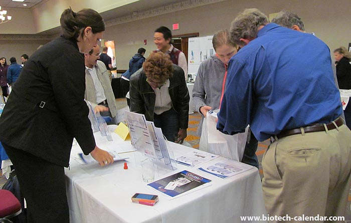 A couple vendors help out some scientists get fresh leads at the Birmingham BioResearch Product Faire™.