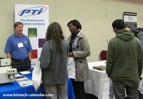 A group of attendees visit the PTI booth at the Birmingham BioResearch Product Faire™.