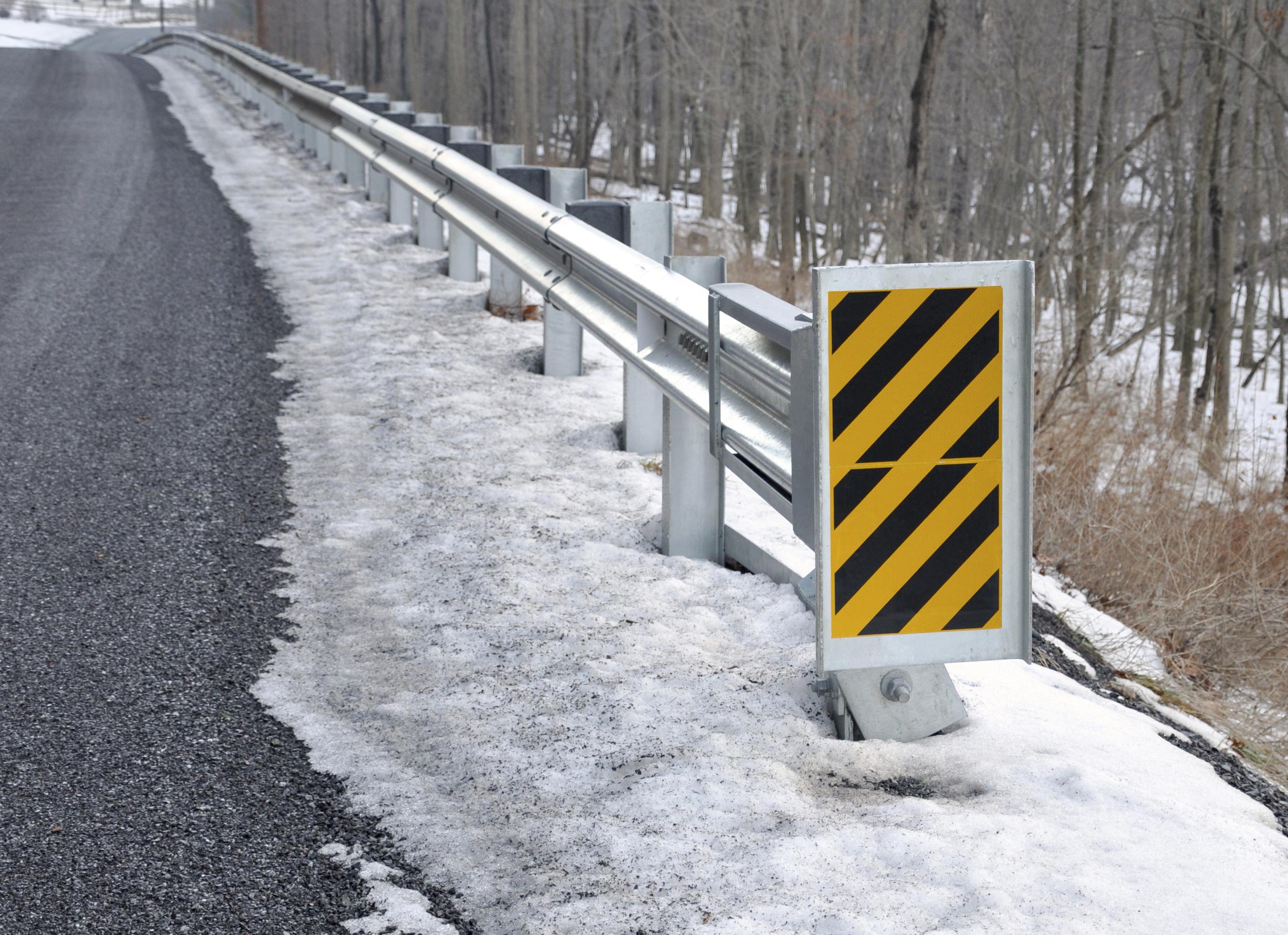 Guardrail end treatments