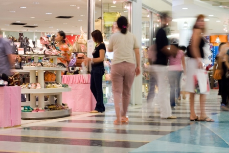 busy shoppers in store without music