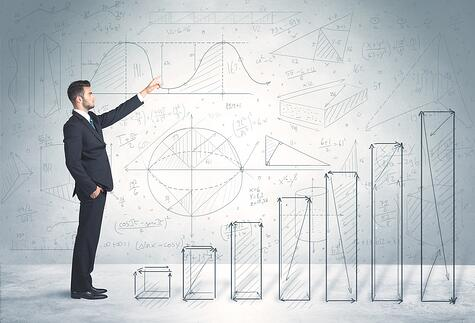 Business man climbing up on hand drawn graphs concept on background-1