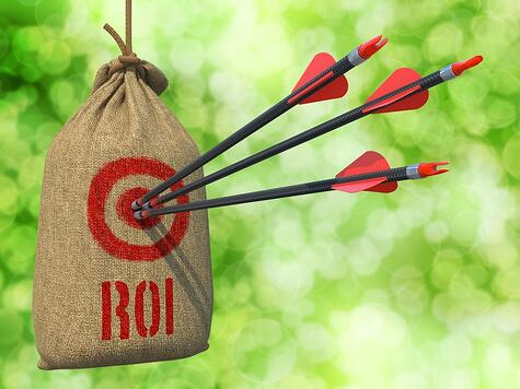ROI - Three Arrows Hit in Red Target on a Hanging Sack on Natural Bokeh Background.