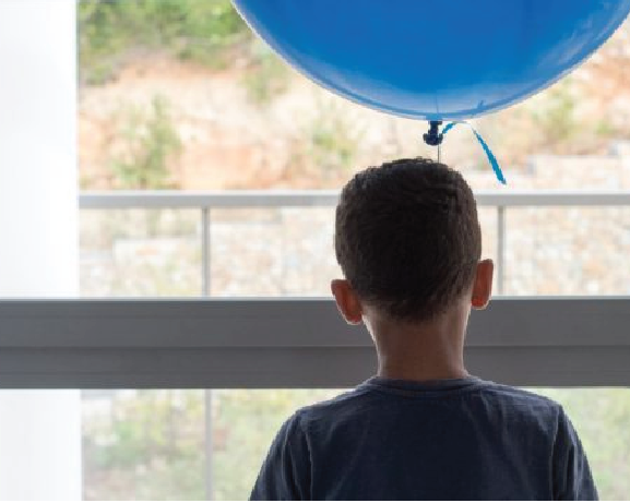 Boy with blue baloon