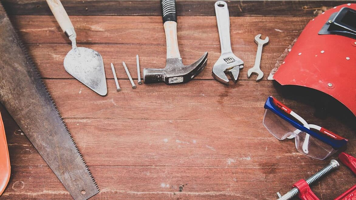 wooden table with various tools