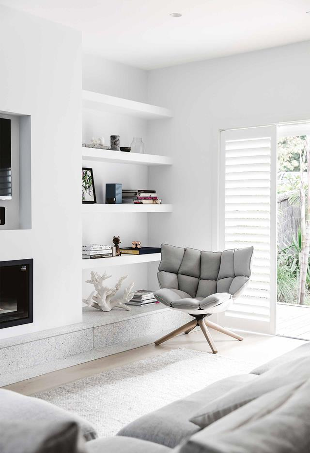 Light grey and white modern living room with shelving storage