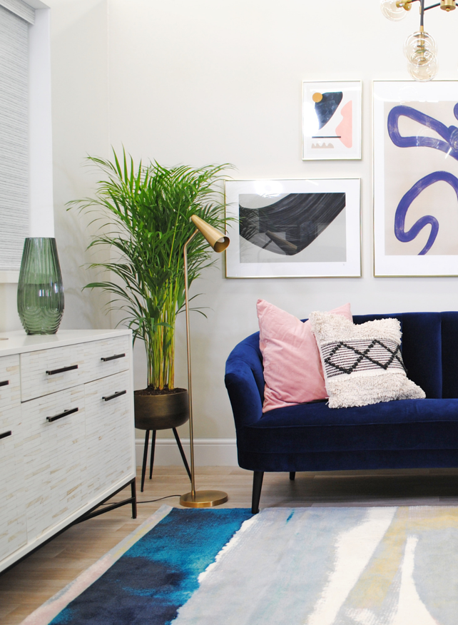 navy sofa in a living room design