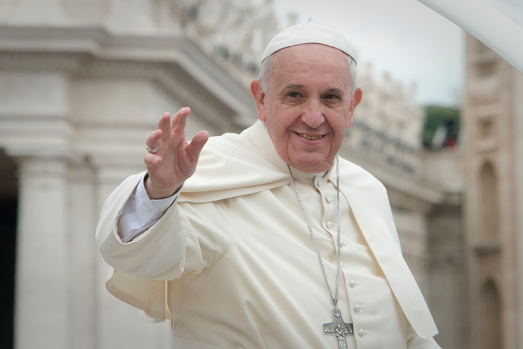 Pope Francis waves to the faithful at the Vatican in Rome.
