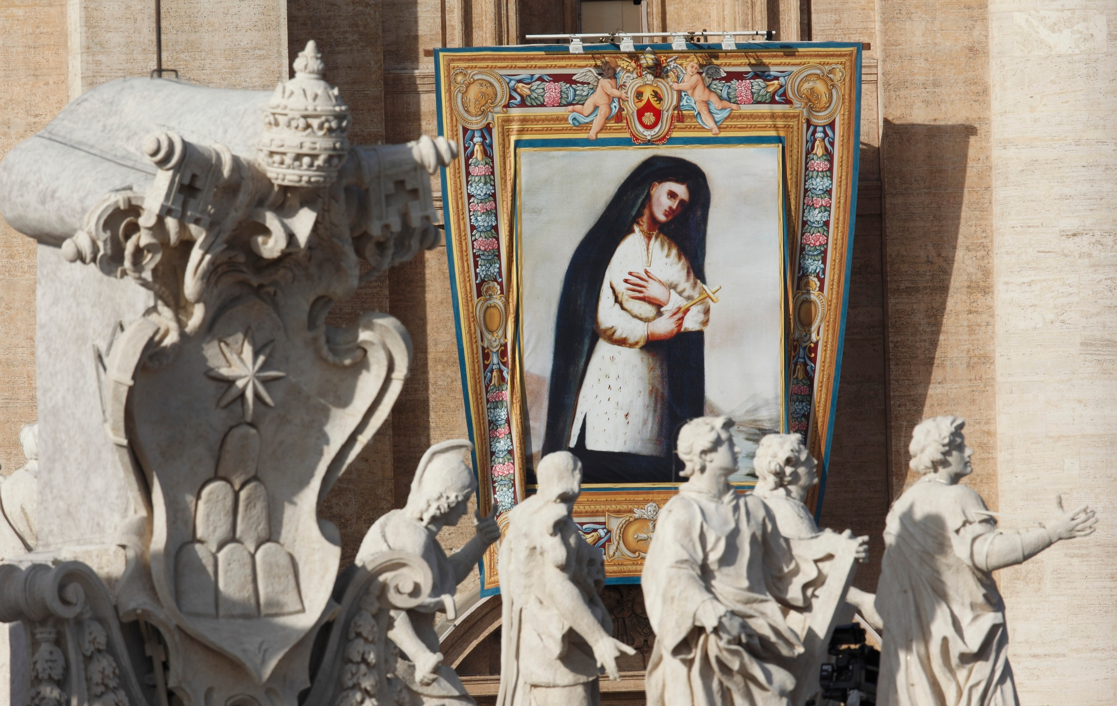 A banner of Saint. Kateri Tekakwitha hangs from the facade of St. Peter's Basilica during the canonization Mass. (CNS photo/Paul Haring)