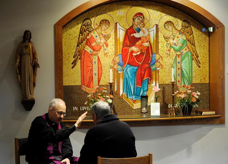 Reconciliation: CNS photo/Mike Crupi, Catholic Courier