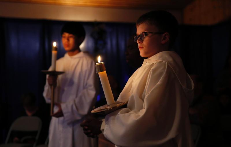 Altar servers prepare for Holy Thursday eucharistic adoration at St. John of the Sea Church in Klawock, Alaska. (CNS photo/ Nancy Wiechec)