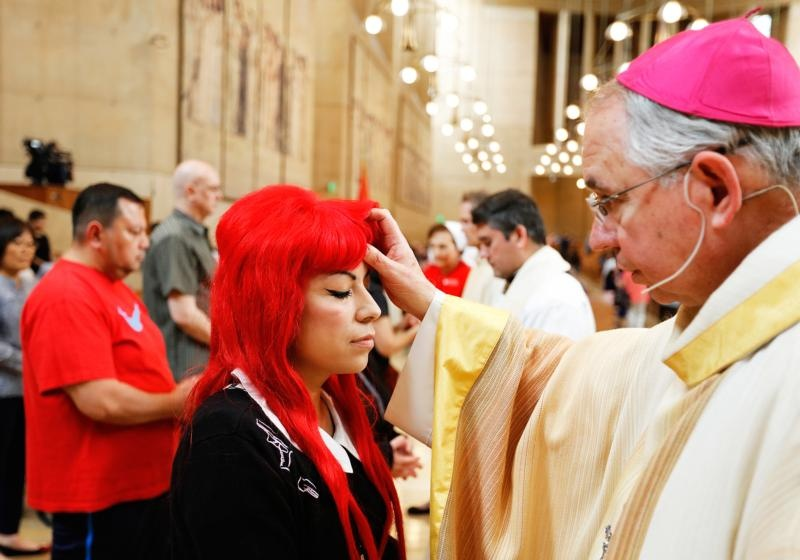 Los Angeles Archbishop Jose H. Gomez blesses a woman during the Anointing of the Sick Feb. 13 at the Cathedral of Our Lady of the Angels in Los Angeles. (CNS photo/Victor Aleman, Vida-Vueva.com)
