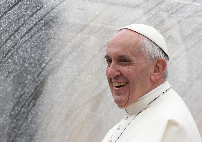Pope Francis smiles as he leaves at the end of the jubilee audience in St. Peter's Square at the Vatican May 14. (CNS photo/Alessaandro Bianchi, Reuters)