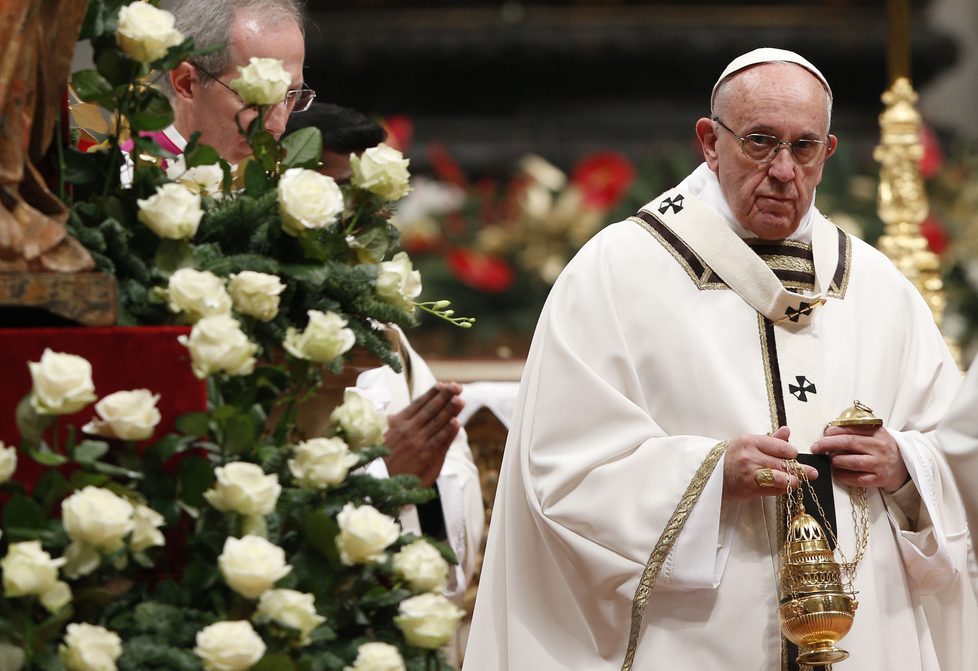 Pope Francis burns incense as he celebrates Christmas Eve Mass in Peter's Basilica at the Vatican Dec. 24. (CNS photo/Paul Haring)
