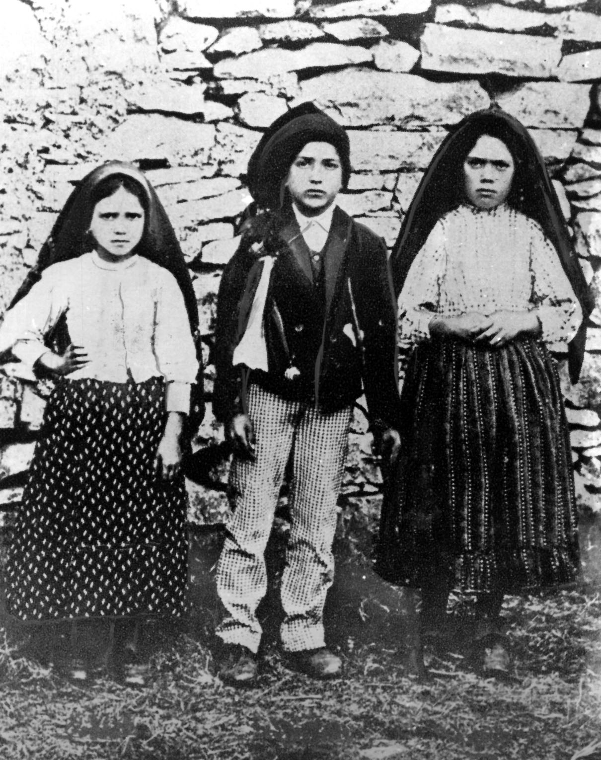 Jacinta and Francisco Marto are pictured with their cousin Lucia dos Santos (right) in a file photo taken around the time of the 1917 apparitions of Mary at Fatima, Portugal. (CNS file photo)