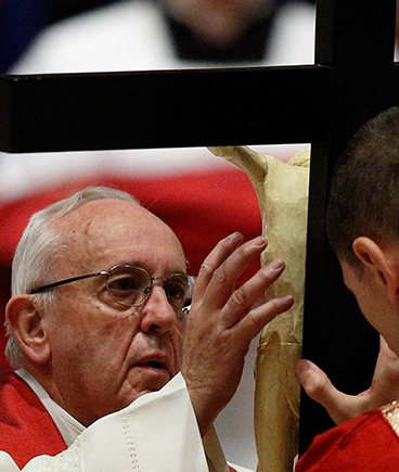 Pope Francis reverences the crucifix on Good Friday