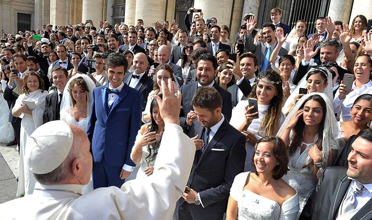Pope Francis greets newly married
