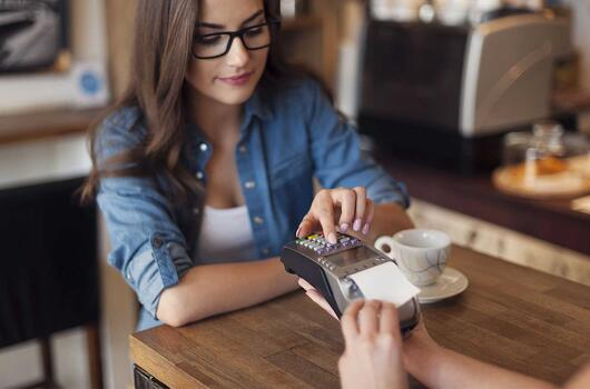 woman paying with card