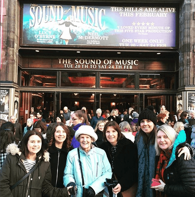 Photo of people waiting outside the theatre