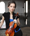 Portrait of Hilary Hahn holding a violin