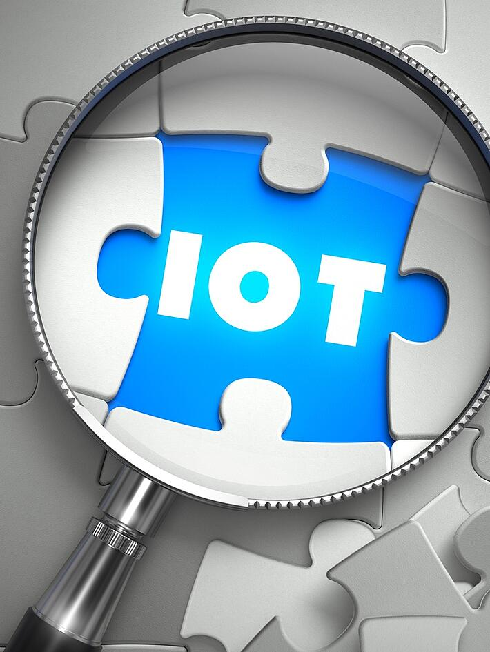 IOT - Word on the Place of Missing Puzzle Piece through Magnifier. Selective Focus.