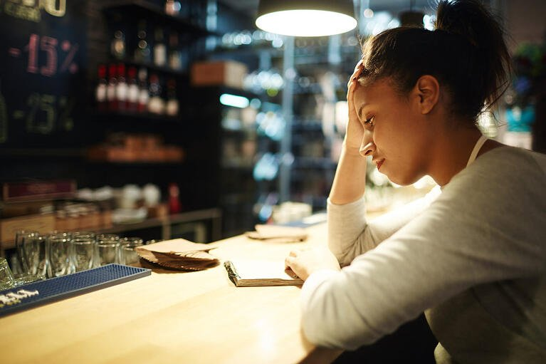bigstock-Tired-waitress-reading-notes-a-218643466-1350x900