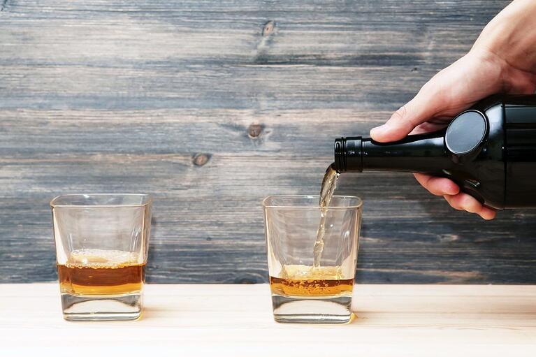 bigstock-bartender-pours-two-glasses-of-109739372-1350x900