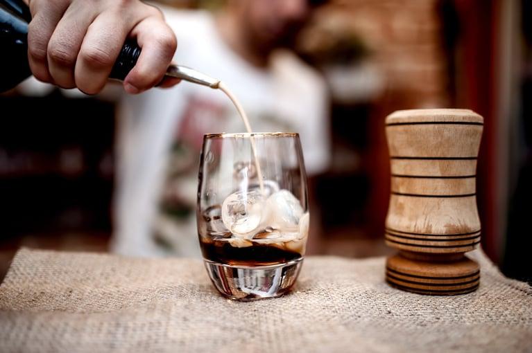 bigstock-Bartender-Pouring-Alcoholic-Li-110733851-1-1352x900-1