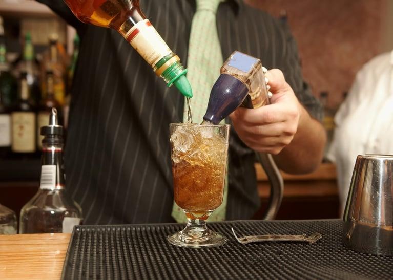bigstock-Bartender-Pouring-Drink-3923583-1260x900