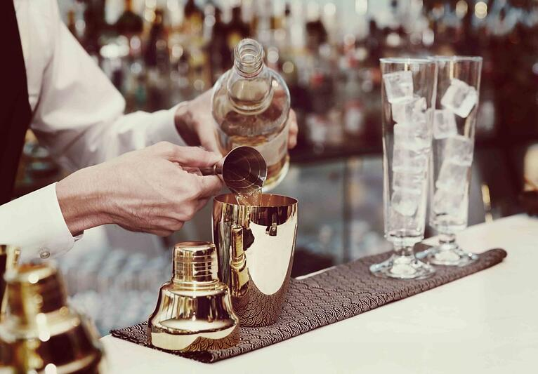 bigstock-Bartender-is-pouring-liquor-in-82647890-1294x900 (1)