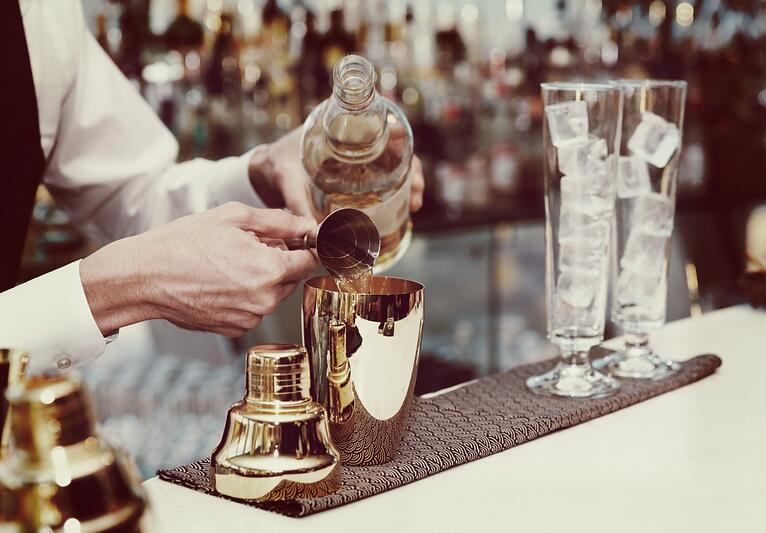 bigstock-Bartender-is-pouring-liquor-in-82647890-1294x900