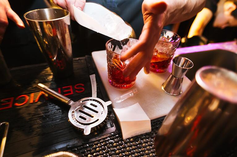 bigstock-Bartender-preparing-a-cocktail-114449300-1-1350x900