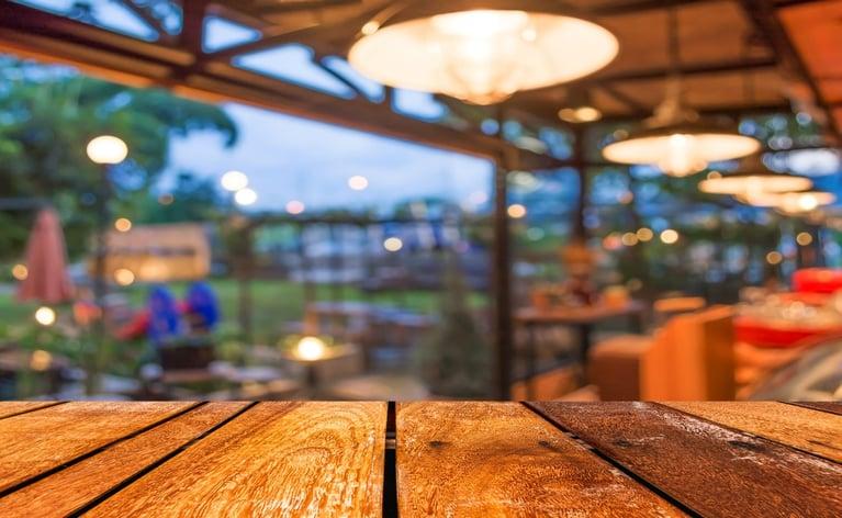 bigstock-Empty-Wood-Table-And-Coffee-Sh-83334128-1440x887