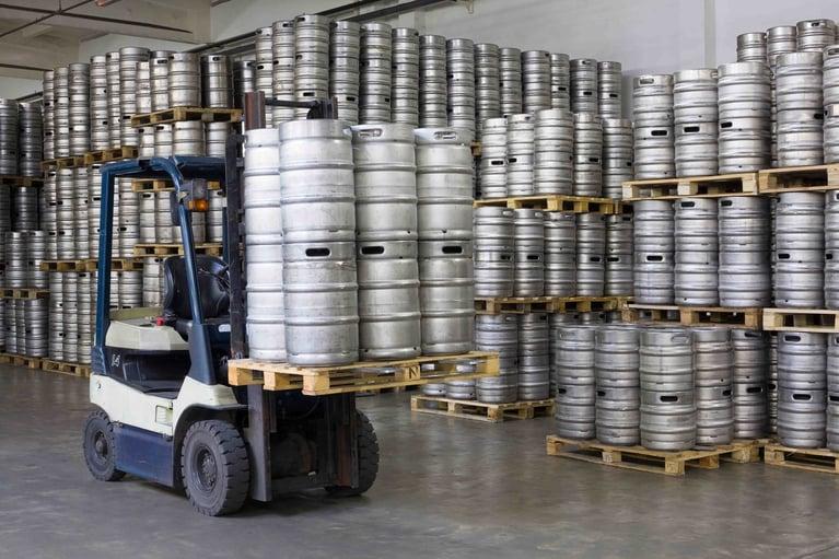 bigstock-Forklift-loading-beer-kegs-in-47956586-1350x900