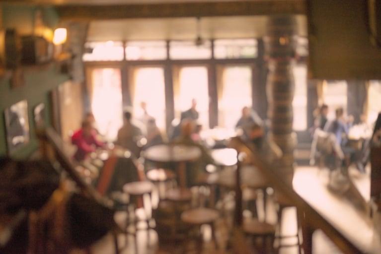 bigstock-People-in-Coffee-shop-blur-bac-85431707-1348x900