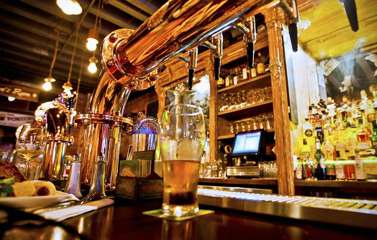bigstock-Pint-of-beer-on-a-bar-in-a-tra-84847739-e1438315322664-1412x900