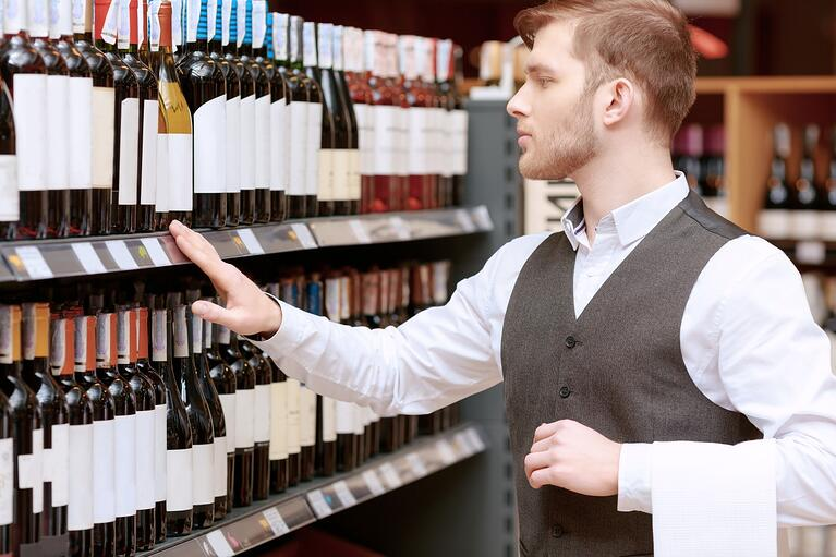 bigstock-Sommelier-in-the-store-near-sh-87069944-1350x900
