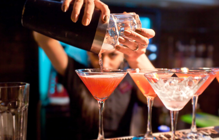 bigstock-The-girl-bartender-prepares-a-106152317-1405x900