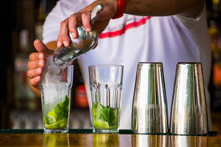 bigstock-barmen-mixes-a-cocktail-33182216-1350x900