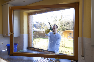 Washing Windows, 8 Easy Yard Care Tips to Help Sell Your Home