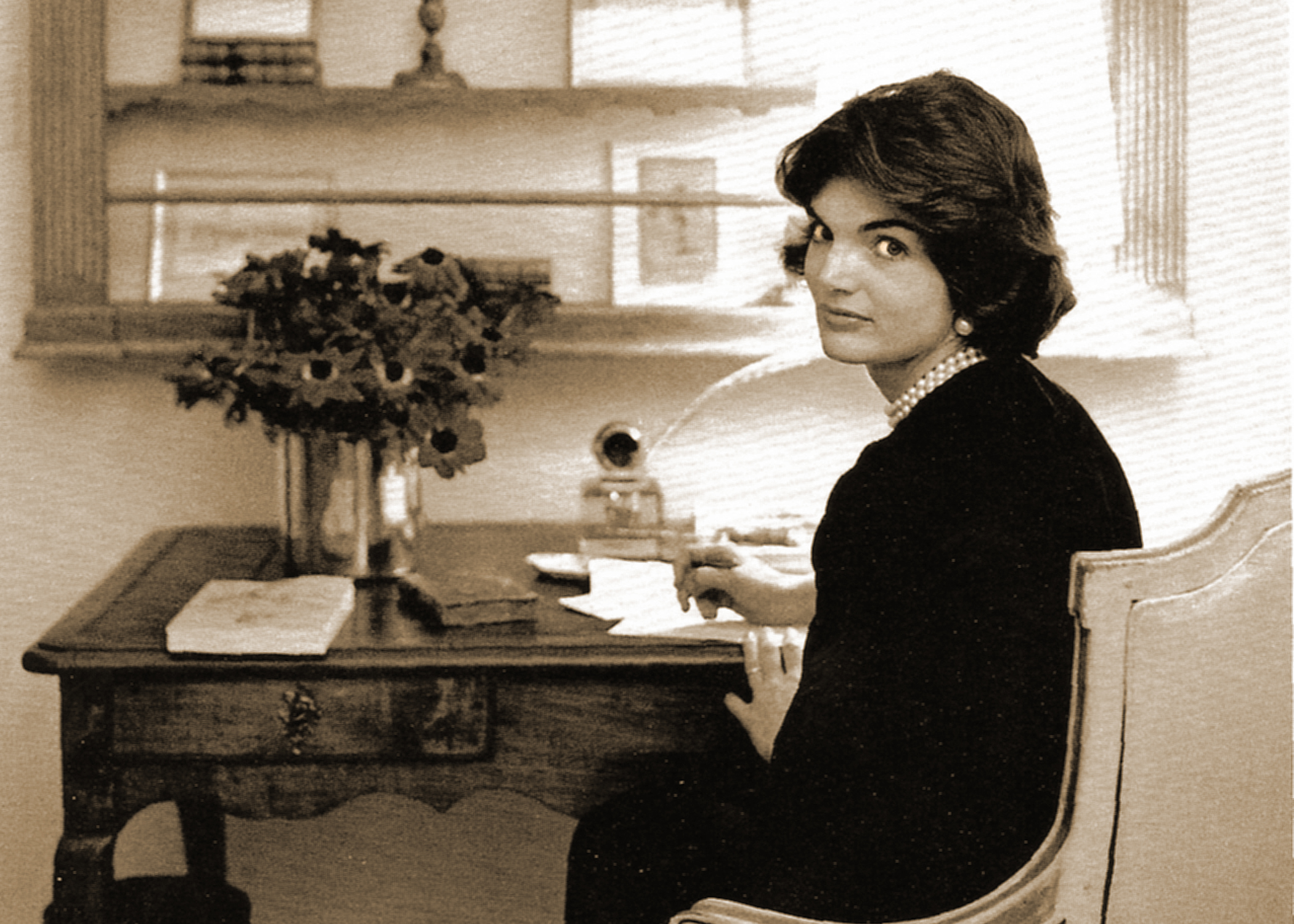 Jacqueline Kennedy at her desk in the White House