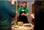 Ryan-Redmond-explains-mussel-salad-dish-boston-globe-e1402918914550.png