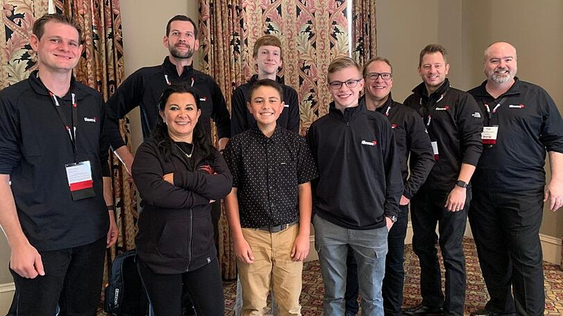 Lafayette Catholic Schools student led tech team members pose with FileWave staff
