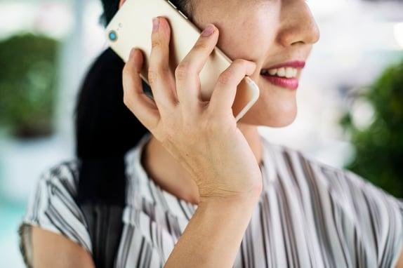Person on phone regarding market research respondent validation